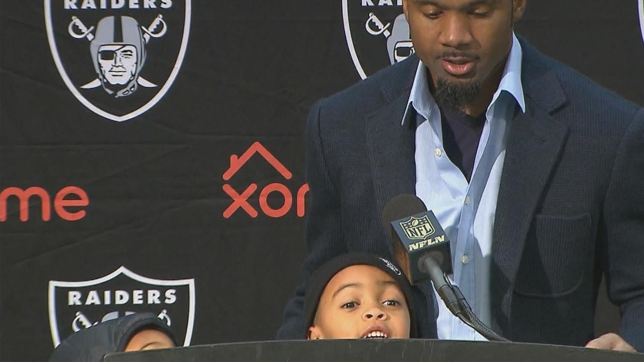 Charles Woodson's son literally steals the mic and tells reporters his dad's the 'best player in the NFL'