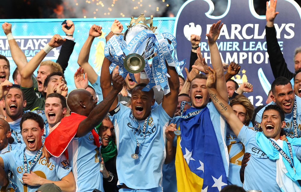 Man. City wins title in injury time