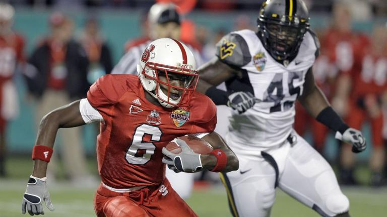 Champs Sports: North Carolina State 23, No. 22 West Virginia 7