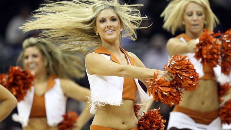 A Texas Longhorns Dancer Performs During Break In The Game Against Baylor Bears Quarterfinals Of Big 12 Tournament At Sprint Center
