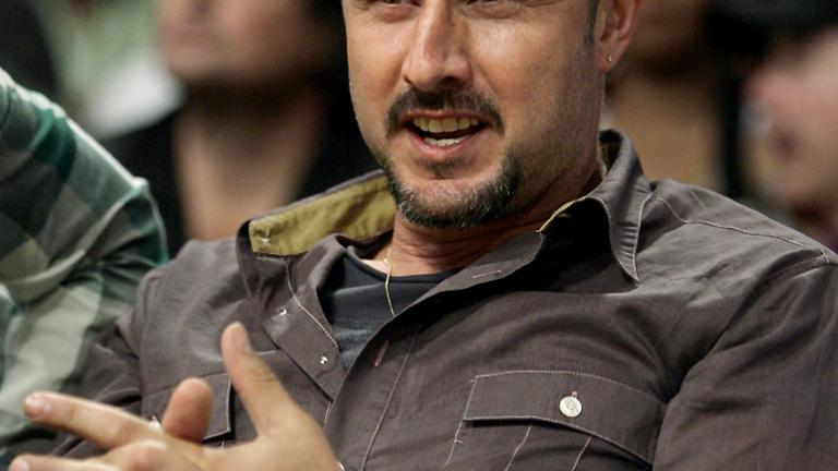 Arquette keeps getting courtside