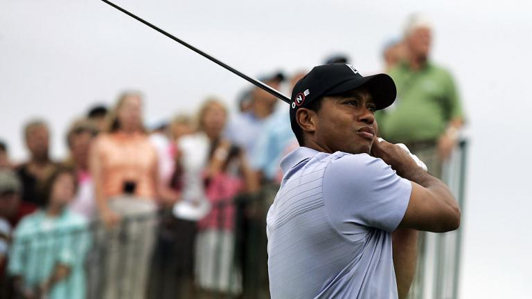 Fans stand for Woods