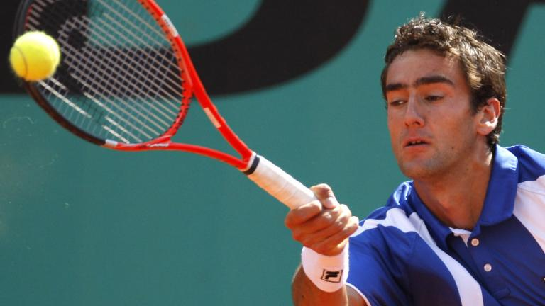 Cilic holds on