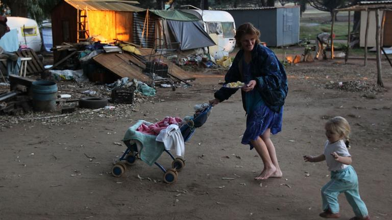 """<div align=""""center""""><span style=""""font-size: 18pt;"""">Poverty-stricken camps surround World Cup grounds</span>"""