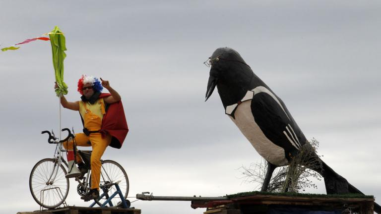 Bird and Cyclist on a wire