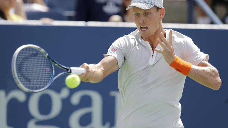Berdych advances to Round Three