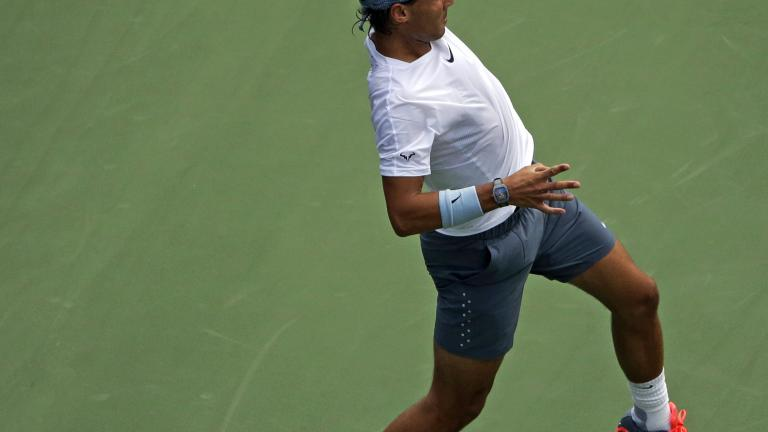Harrison falls to Nadal in first round