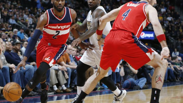 John Wall's 16 assists power Wizards past Nuggets in overtime