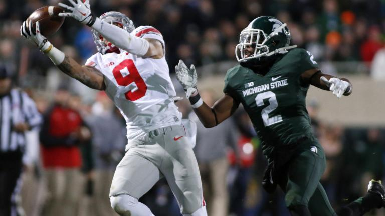 (14) Ohio State 49, (8) Michigan State 37