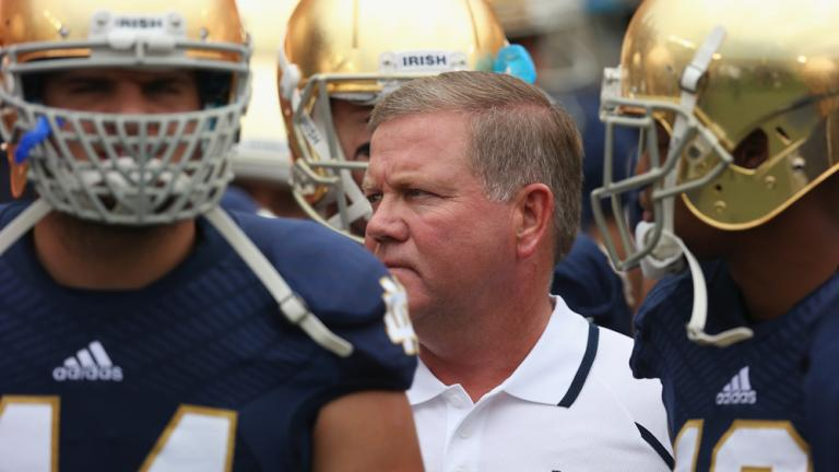 Brian Kelly waits with his team