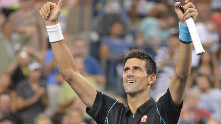 Djokovic advances, again