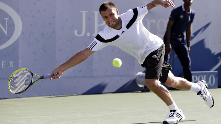 Youzhny takes down Hewitt in 5 sets