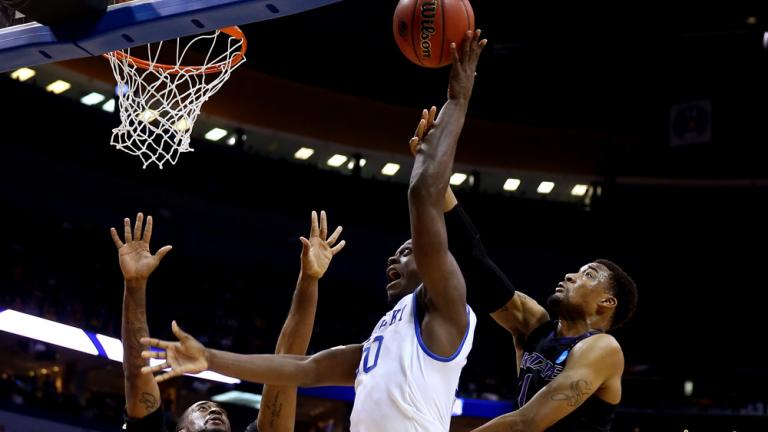 Second Round: (8) Kentucky 56, (9) Kansas State 49
