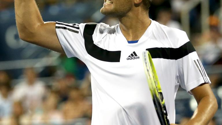 Youzhny celebrates a point