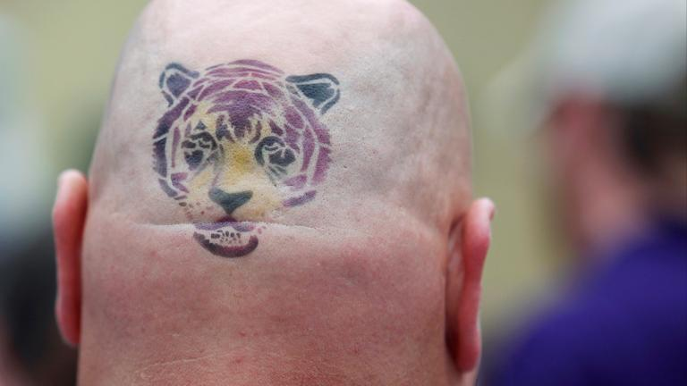 The man with the tiger tatoo