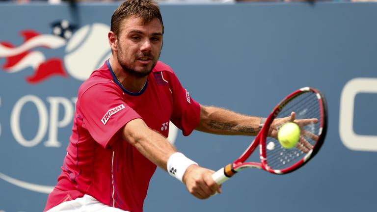 Wawrinka takes down Baghdatis in four