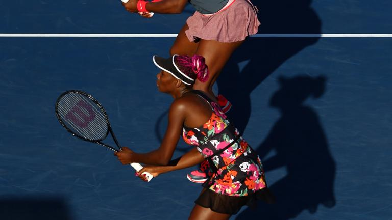 Williams sisters advance to quarterfinals