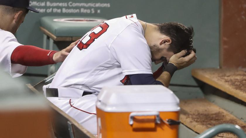 Michael Chavis in the Red Sox dugout after striking out five times vs. the Phillies