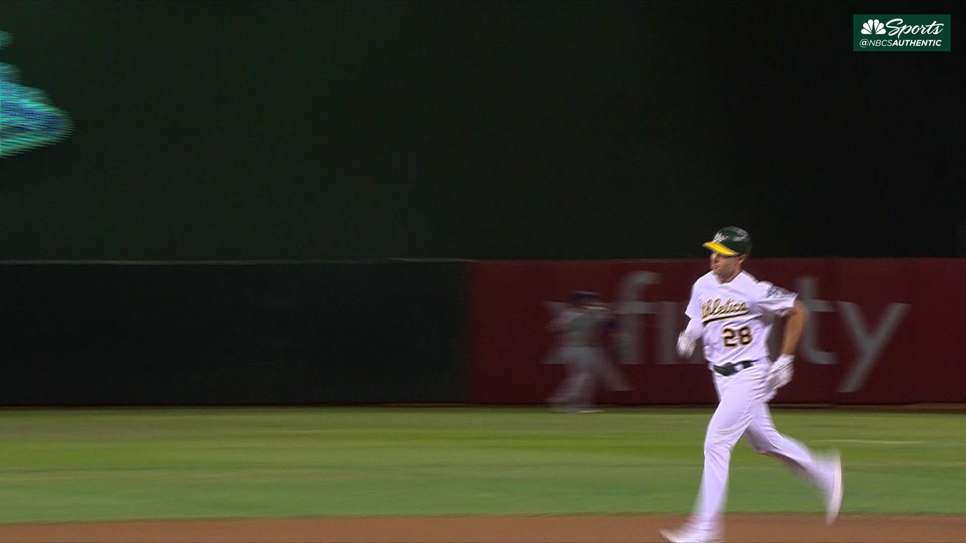 A's rally in seventh inning to beat Royals, take top wild-card spot