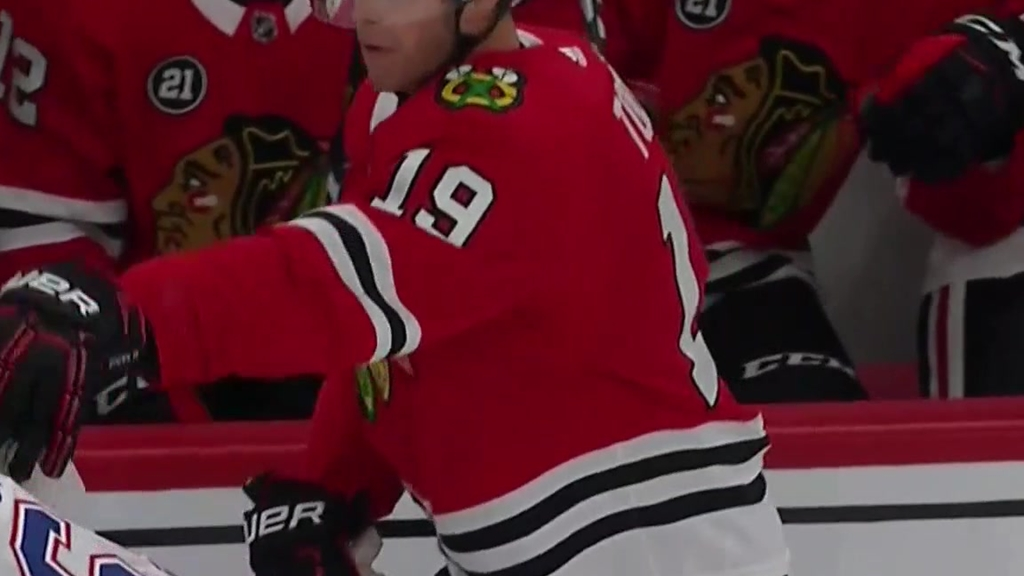 Andrew Shaw scraps with Jonathan Toews