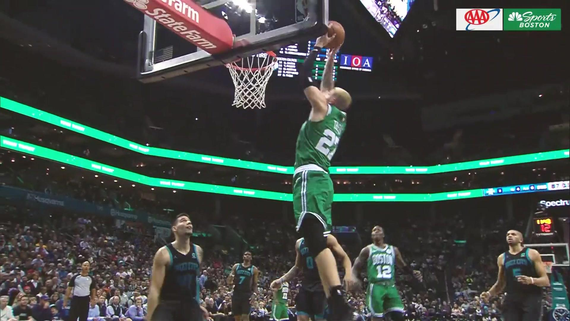 Kyrie Irving battles for rebound, leads to alley-oop jam from Daniel Theis