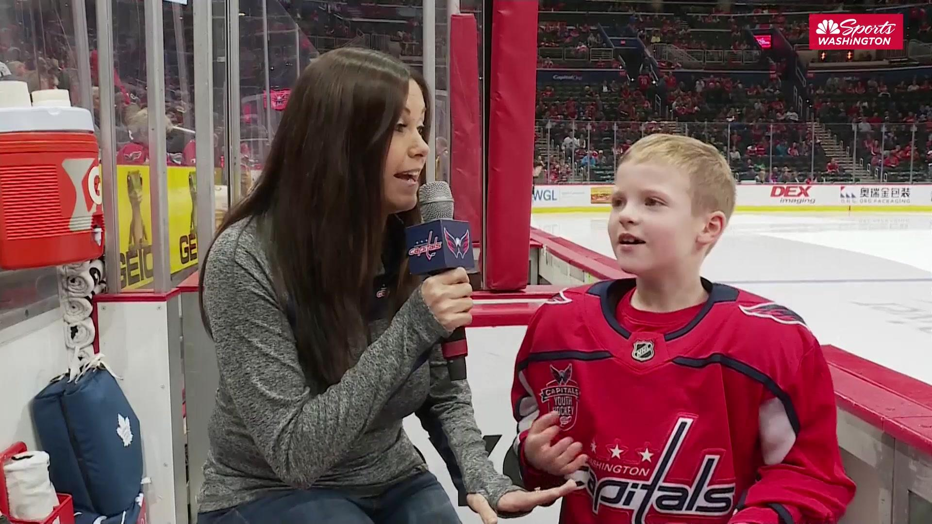 Mite on Ice hockey player during Capitals intermission loves everyone
