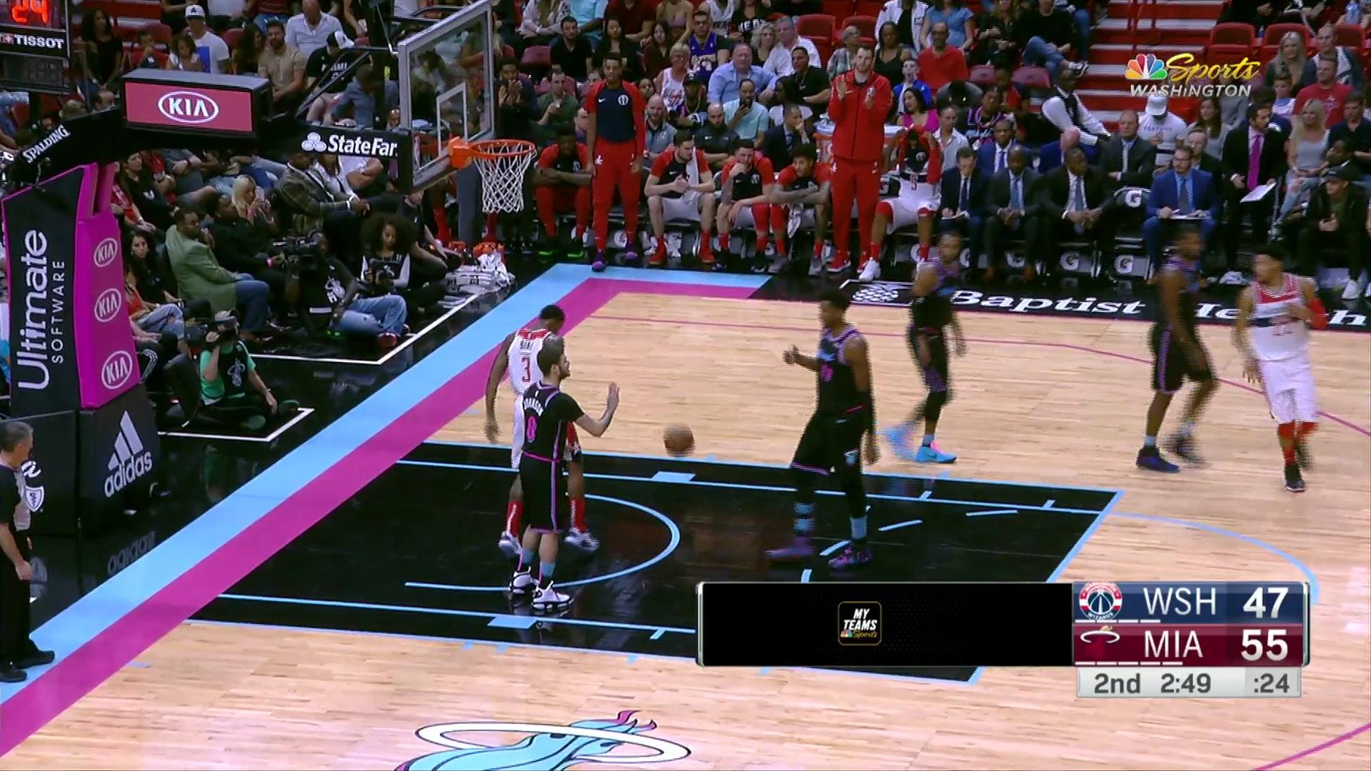 Beal skies high meeting Wall's dime at the rim for the flush